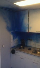 Photo of the result of a blue spray can that had exploded
